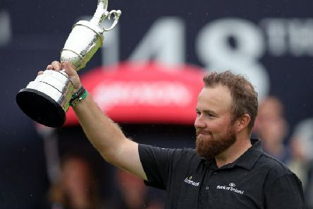 Shane Lowry celebrates with Claret Jug after winning The Open Championship 2019 at Royal Portrush Golf Club.  David Davies/PA Wire