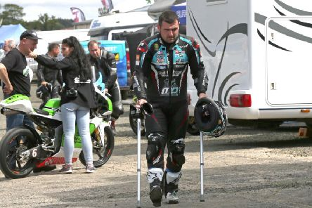 Michael Dunlop hobbled around the paddock at Armoy on crutches, but it didn't stop him winning both Superbike races on the Tyco BMW. Picture: Stephen Davison/Pacemaker Press.
