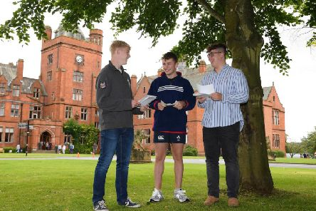 Rex Tinsley, Max McDermott and John Gildea with their A level results at Campbell College in Belfast.