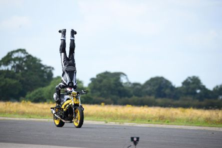 Handout photo dated 17/08/19 courtesy of Harvey Brewster of Marco George, whose attempt to break the world record for fastest ever headstand on a motorcycle is expected to be ratified by the Guinness World Records, after he clocked a speed of 76.1764mph