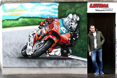 William Dunlop's former sponsor Paddy Flynn pictured at the mural at Abetta Parade in East Belfast showing the Ballymoney racer on Flynn's 250cc Honda. Picture: Stephen Davison/Pacemaker Press.