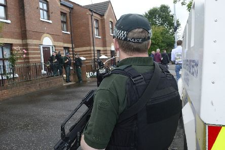 PSNI officers outside the house of Alex Murphy on the Falls road in Belfast on Tuesday