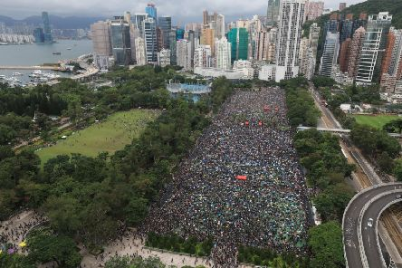 "Protesters gather during a rally at Victoria Park in Hong Kong on Sunday, Aug. 18, 2019. ""Too few international voices have criticised China's blatant breach of its obligations but the Hong Kong people have not stayed silent"" ''(Apple Daily via AP)"