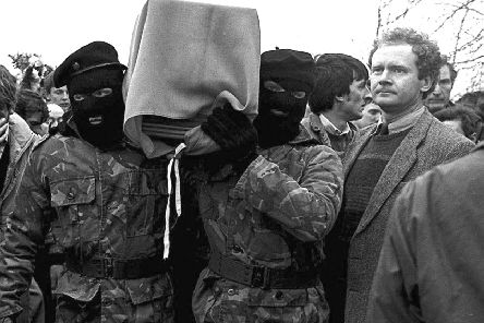 Martin McGuinness, pictured here alongside masked IRA men in 1988, claimed that the IRA was nothing to do with him