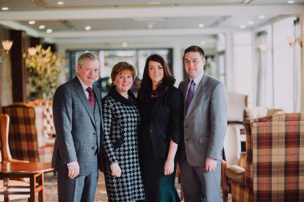 The McKeever family: Eugene and Catherine with daughter Bridgene and son Eddie, owners of Corr's Corner Hotel, which is celebrating its centenary
