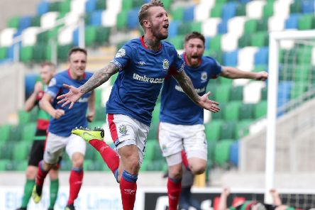 Kirk Millar celebrates scoring the only goal in Saturday's win for Linfield against Glentoran. Pic by Pacemaker.