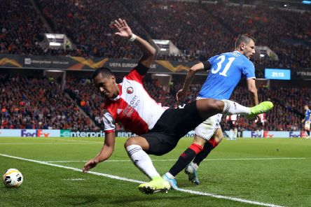 Feyenoord's Renato Tapia (left) and Rangers' Borna Barisic battle for the ball during the UEFA Europa League Group G match at Ibrox on Thursday. Pic by PA Wire.