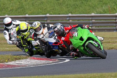 Graeme Irwin leads Carl Phillips, Alistair Kirk and Gerard Kinghan in the Superbike class at Bishopscourt. Picture: Derek Wilson/Pacemaker Press.