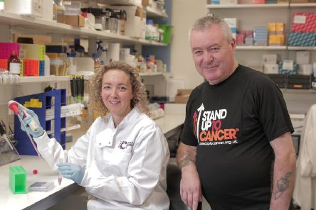 Belfast scientist Dr Vicky Coyle with bowel cancer survivor Robert McCartney from Woodvale in Belfast