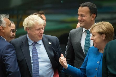 Prime Minister Boris Johnson (centre left) with Taoiseach Leo Varadkar (2nd right) and Chancellor of Germany Angela Merkel at a round table for the European Council summit at EU headquarters in Brussels. PA Photo. Picture date: Thursday October 17, 2019. See PA story POLITICS Brexit. Photo credit should read: Stefan Rousseau/PA Wire