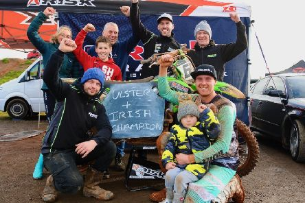 John Meara and team celebrate doing the MX1 double in 2019