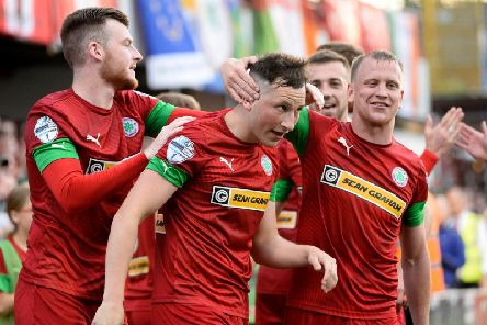 Conor McDermott celebrates scoring a wonder goal from the halfway line against Warrenpoint.