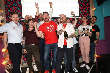 LGBT campaigners celebrated in Belfast after MPs voted to bring gay marriage to NI in July