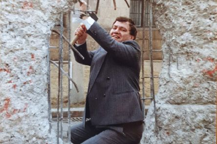 """John Cushnahan, then an MEP who prior to that had been the leader of the Alliance Party, at the Berlin Wall in 1989, not long after he was elected to Strasbourg. """"I expressed my solidarity with the people of Germany and joined those who demolished the wall and consigned all that it represented to the dustbin of history"""""""