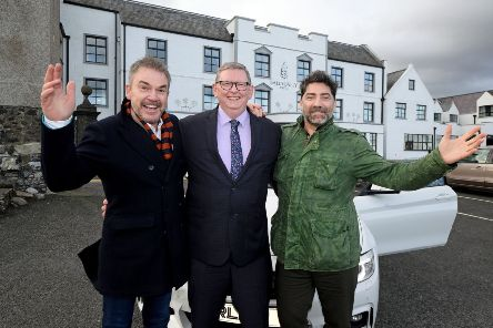 Brian Kennedy launches his Christmas concerts at The Ballygally Castle  with Norman McBride, hotel manager and Philip McGarrity from Philip McGarrity Motors, the concert sponsors.