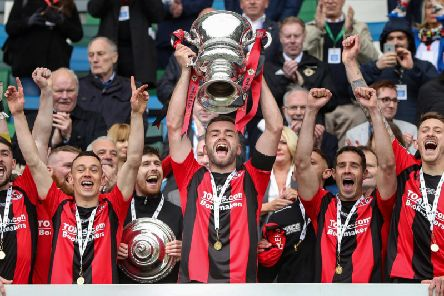 Crusaders celebrate winning the Irish Cup last season.
