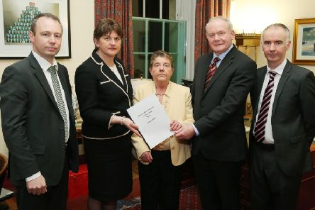 Then 'first minister, Arlene Foster, and deputy first minister Martin McGuinness receiving welfare reform proposals from Professor Eileen Evason (centre), Barry McVeigh (left) and Kevin Higgins (right) in January 2016