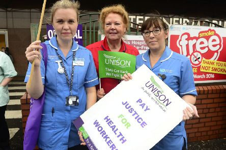 Pacemaker Press 25-11-2019 Members of Northern Ireland's largest health workers' union pictured on strike over pay and staffing levels. Unison represents about 25,000 healthcare workers including nurses, social care staff, support services but not doctors. The first phase of industrial action will run from 25 November until 18 December and phase two will run to March 2020. Members pictured on strike outside The Mater Hospital in Belfast.'Picture By: Arthur Allison/ Pacemaker Press.