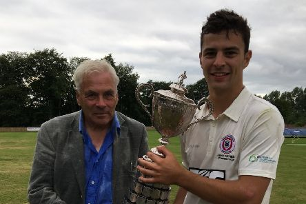 Templepatrick CC president Arthur Bowron and First XI captain Ross Bryans with the Junior Cup. PICTURE: Duncan Elder