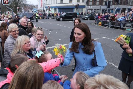The Duchess of Cambridge receives flowers during a walkabout outside the Braid Arts Centre in Ballymena as part of their two day tour to Northern Ireland. PRESS ASSOCIATION Photo. Picture date: Thursday February 28, 2019. See PA story ROYAL Cambridge. Photo credit should read: Niall Carson/PA Wire