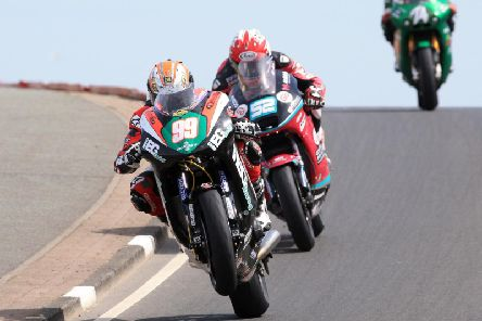 Jeremy McWilliams (KMR Kawasaki) leads Adam McLean (McAdoo Kawasaki) at the North West 200 in 2018.