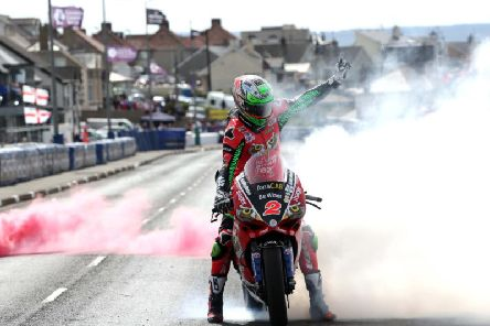 Glenn Irwin celebrates victory in the feature North West 200 Superbike race in 2018 on the PBM Be Wiser Ducati.