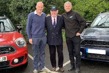 Race ace Paddy Hopkirk and his son Patrick with Richard Gladman (right) from IAM RoadSmart.