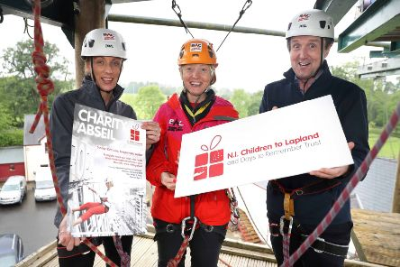 Jim Burke and Lorraine Weir from Hagan Homes in training with Nicola Campbell at Belfast Activity Centre for the Adventure Abseil on Sunday, June 23 at the Europa Hotel in aid of NI Children to Lapland and Days to Remember Trust. Photo by  Philip Magowan /  Press Eye.