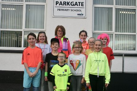 The whole school took part in an initiative aimed at increasing activity levels as families ditched their cars in favour of walking, cycling or scooting to school.'Pupils donned their brightest outfits to ensure they were visible to motorists as part of the Sustrans Active Schools Ditch the Dark Day event.