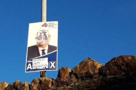 A defaced UUP poster in the Victoria Road area of Larne.