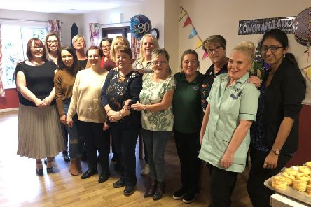 Staff with Anne Watters celebrating her long service at the home.