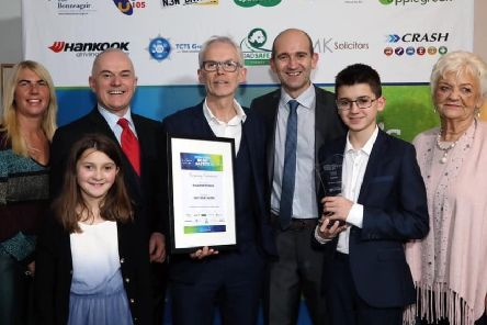 Lisa Hamilton (Secretary), Pat Martin (Chair of Road Safe NI and NRSC), Steve Carter, two of his children, Tony McGinn (Specsavers Newtownabbey, award sponsor) and Frank Mitchell.