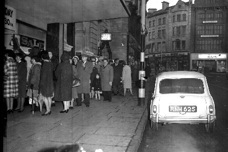 The queue for Adnitt's new year sale snakes down The Drapery, Northampton, on January 1, 1965