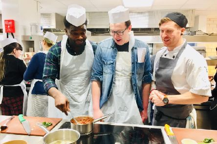 Pictured from left are students Alphonse Okamba and Tom Marshall with chef David Lively.