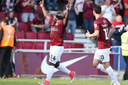 Junior Morias celebrates his late strike for the Cobblers in the 3-1 win over Macclesfield (Pictures: Pete Norton)