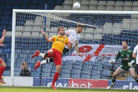 Andy Williams challenges for the ball. Pictures: Pete Norton