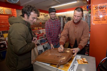 Sleaford Mods pictured signing a fan's bin lid.