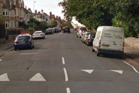 A woman was robbed by two men on a moped while she was sat in her car.