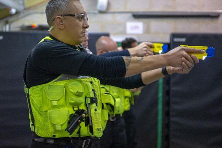 An officer practicing using a Taser. Photo: Northamptonshire Police