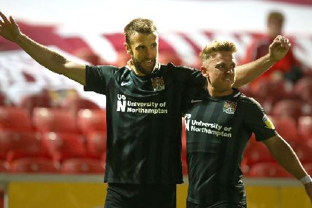 Andy Williams celebrates his goal with Sam Hoskins. Picture: Pete Norton