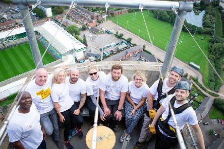 The David Wilson Homes representatives at the top of the tower after completing the abseil