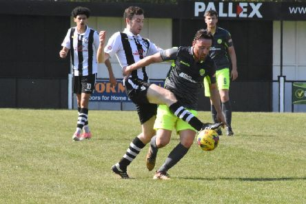 Joe Curtis battles for possession for AFC Rushden & Diamonds during their 5-0 defeat at Coalville Town on Saturday. Picture courtesy of HawkinsImages