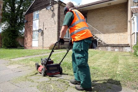 Grass cutting row: A council worker trims a public piece of grass on the Beanfield estate.