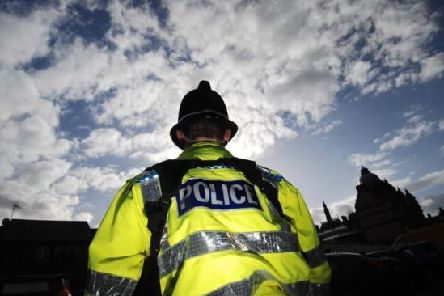 Three men in tracksuits robbed a passerby of his phone in Northampton.