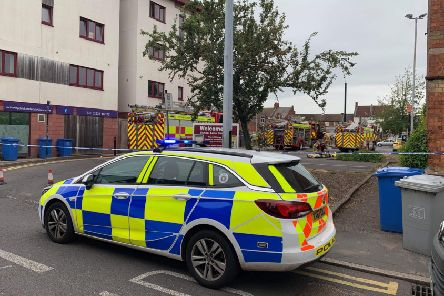Firefighters at the scene of the gas leak in School Lane, Kettering. Picture by Cameron Walton
