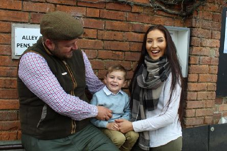 George with his parents Will and Natasha.
