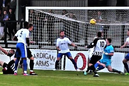 Steve Diggin scores the opening goal in Corby Town's 3-1 victory over Coleshill Town. Picture by David Tilley
