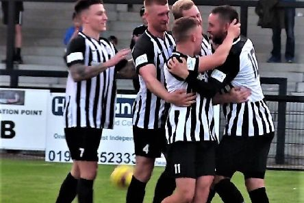 Steve Diggin takes the congratulations after he grabbed the opening goal in Corby Town's 3-1 success over Coleshill Town. Picture by David Tilley