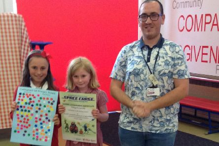 Max Robinson from Corby Library with Cottingham pupils Poppy, 10, and Hope, 7.