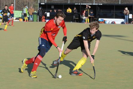 Adam Wilson (red) on the attack for City of Peterborough against Beeston. Photo: David Lowndes.